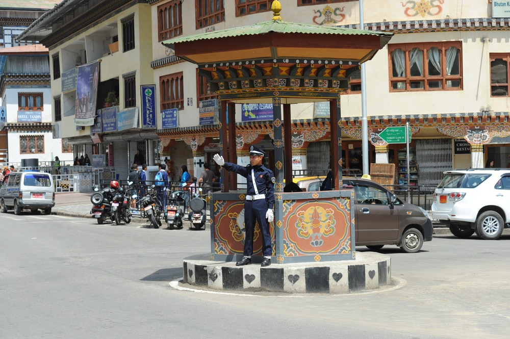 A traffic officer in the capital city directs traffic