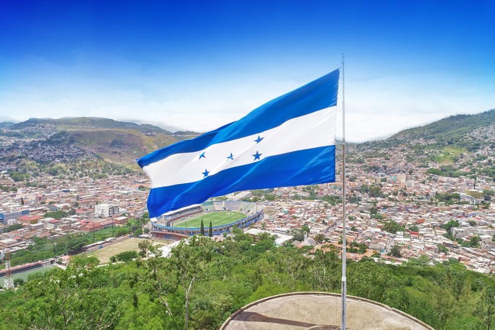 The Honduran flag flies above Tegucigalpa