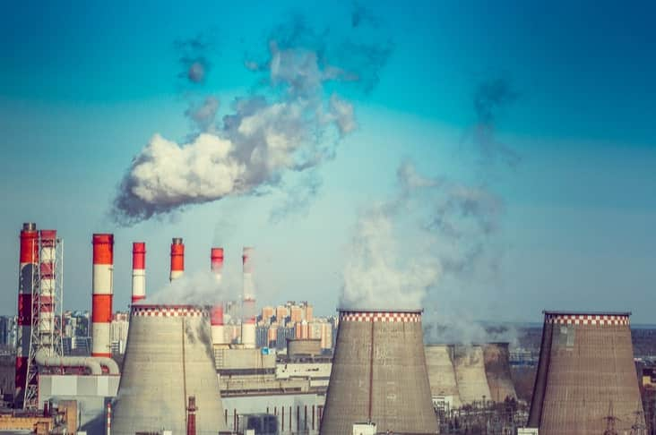 A power station and clouds of CO2 emissions