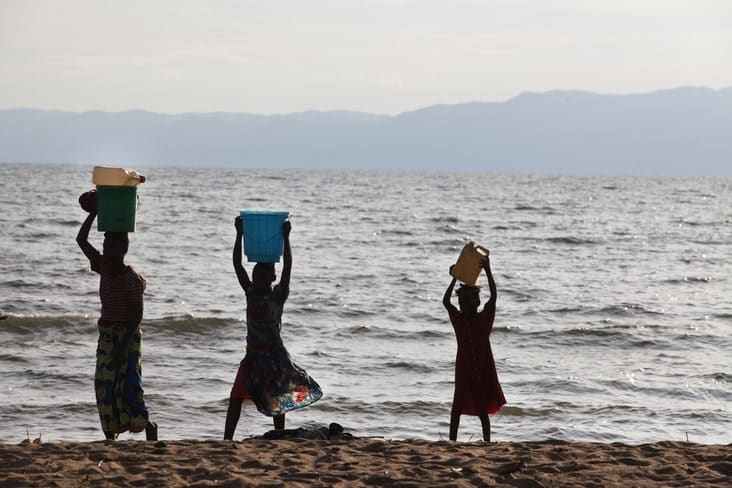 Burundians carrying water near Lake Tanganyika
