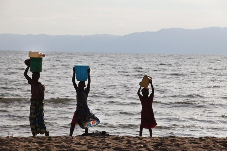 Burundians carrying water near Lake Tanganyika