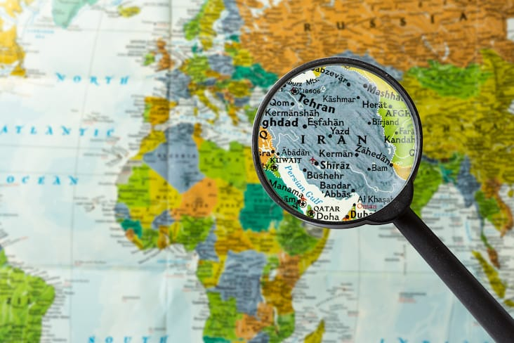 Map of Iran seen through a magnifying glass