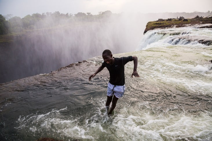 A man jumps into the Devil's Pool