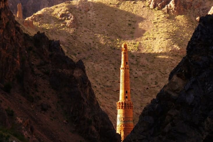 The Minaret of Jam between two mountain slopes