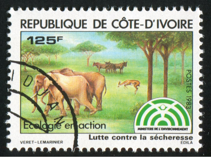 A 1983 Ivory Coast depicting elephants and reading Côte d'Ivoire