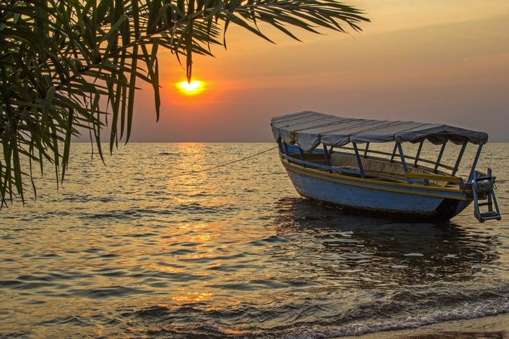 A fishing boat during sunset on Lake Victoria