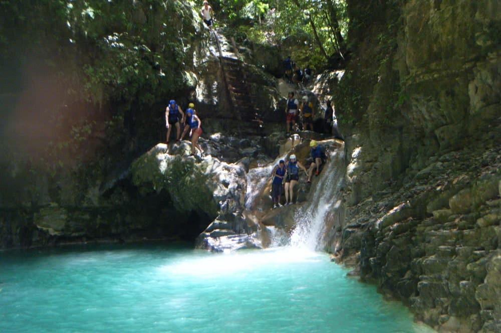 A bright bright green waterfall in the Dominican Republic